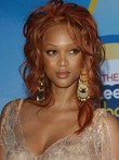 Tyra Banks Remy Hair Wavy Romantic Lace Front Wig